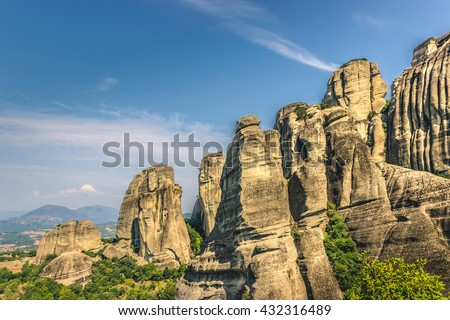 Greece. Meteora Panoramic view - incredible sandstone rock formations. The Holly Monastery of Rousanou and St. Nikolaos Anapafsas Monastery in background. The Meteora area is on UNESCO  - stock photo