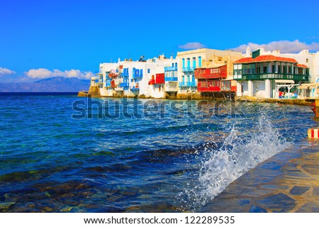Greece Mykonos, Little Venice with splashing waves in Mykonos island Greece Cyclades - stock photo