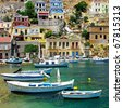 Greece - pictorial island Symi bay with boats - stock photo