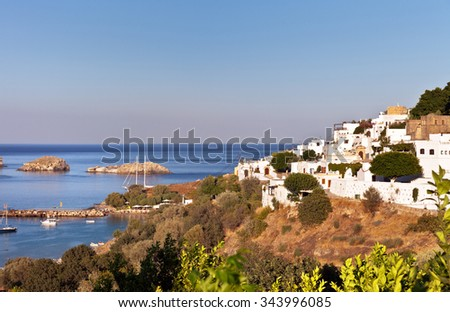 Greece. Rhodes Island. The town of Lindos and sea bay at sunset - stock photo