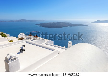 Greece Santorini island panoramic view of the sea, above oia in  caldera with rooftops of whitewashed houses with sea background in Cyclades - stock photo