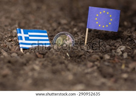 Greece sinking into earth together with the euro - stock photo