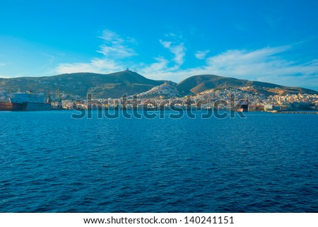 Greece Syros island in Cyclades, main port panoramic view on a summer sunny day - stock photo