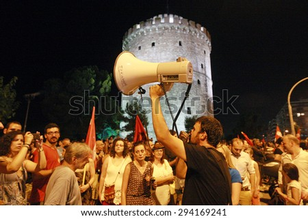 GREECE, Thessaloniki JULY 5, 2015: Supporters of the NO vote celebrate for the final NO result in the crucial greek referendum around the White Tower in Thessaloniki - stock photo