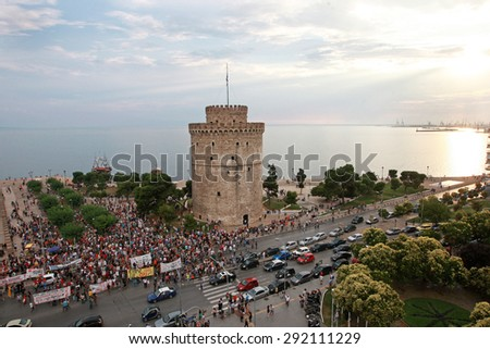 GREECE, Thessaloniki JUNE 29, 2015: Supporters of the NO vote in the upcoming referendum protest holding banners reading NO (OXI in greek) during a rally around the White Tower in Thessaloniki - stock photo