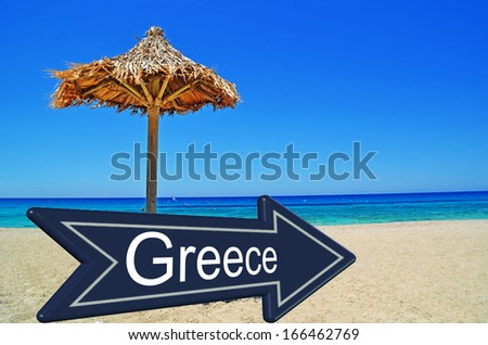 Greece traffic sign - beach summer umbrella vacations - sea and blue sky - stock photo