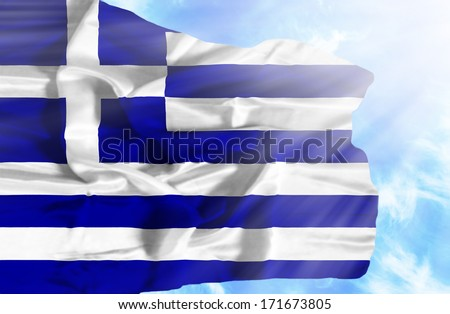 Greece waving flag against blue sky with sunrays - stock photo