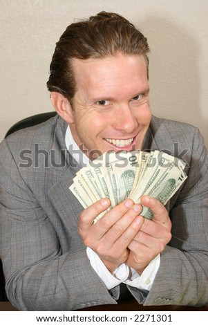 Greedy businessman with stack of money. - stock photo