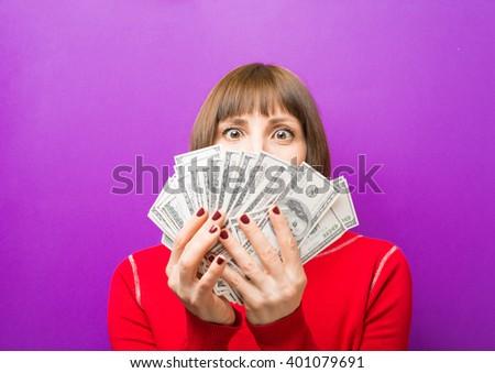 greedy girl with dollars - stock photo