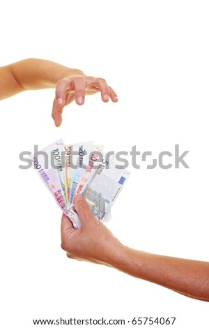 Greedy hand reaching for many Euro banknotes - stock photo