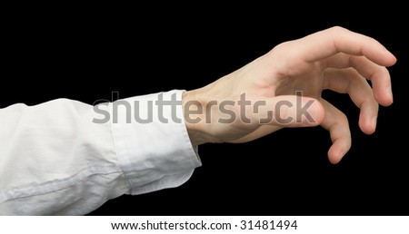 Greedy hand with crooked fingers on a black background