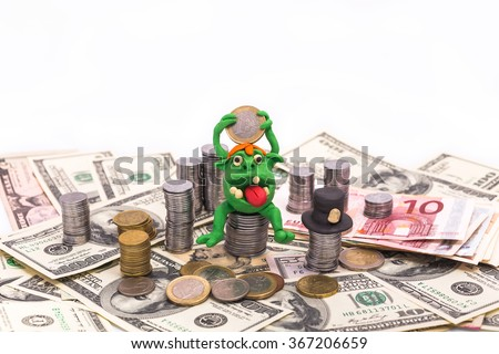 Greedy Leprechaun on the pile of money with euro coin - finance concept isolated on white - stock photo