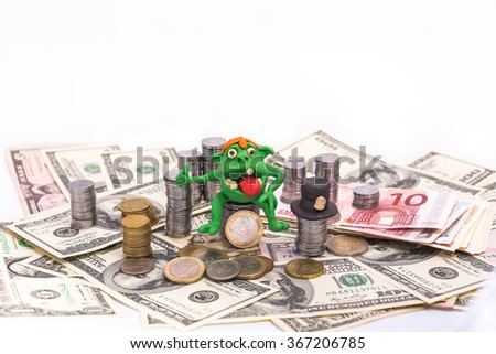 Greedy Leprechaun on the pile of money with thumb up - finance concept isolated on white - stock photo