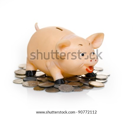 greedy piggy bank on a light background - stock photo