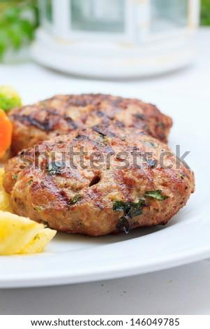 Greek Bifteki with fries and vegetables