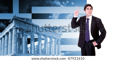 Greek business man with the Parthenon in Acropolis, Athens Greece and Greek flag