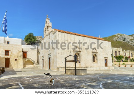 Greek cats next to beautiful orthodox temple in the picturesque Patriarchal Monastery of Saint John the Theologian, known as the Monastery of Preveli.District of Rethymno.Crete island.Greece.Europe.