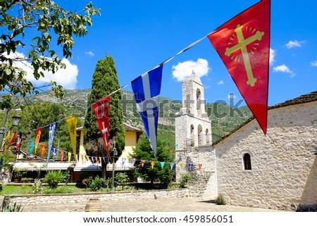 Greek church bell tower on the island of Ioannina, lake Pamvotida, Epirus region Greece. NOTE: Focus on bell tower. - stock photo
