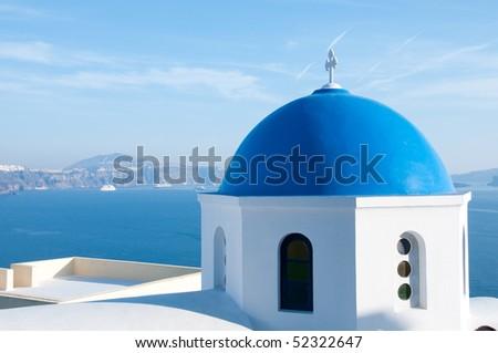 Greek church in santorini greece with a cross - stock photo