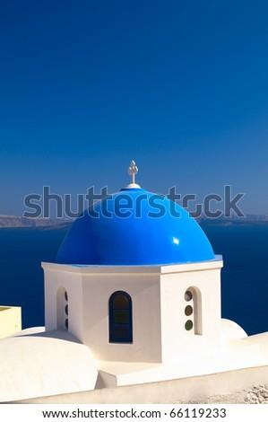 Greek church in Santorini island with a cross - stock photo