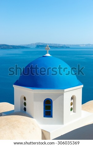 Greek church with blue dome near the sea in Oia town, Santorini island, Greece - stock photo