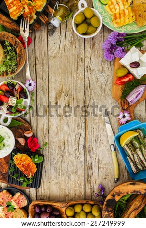Greek cuisine dishes - frame with copy space - stock photo