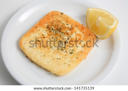 greek cuisine fried hard  cheese served on a plate - stock photo