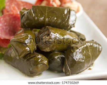 Greek dolmades wrapped with vine leaves feature in a mezze platter.