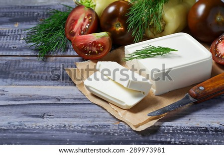 Greek feta cheese with vegetables. Selective focus - stock photo