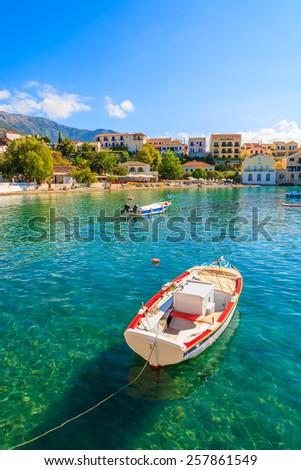 Greek fishing boat on sea in beautiful bay, Assos village, Kefalonia island, Greece - stock photo