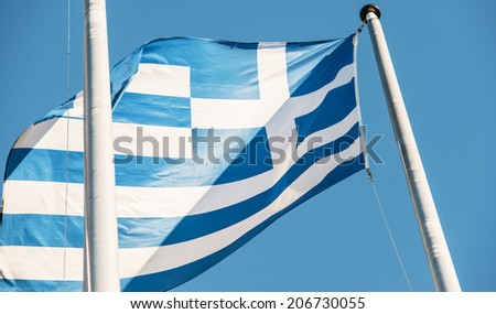 Greek flag in front of the EU Commission building in Brussels - stock photo