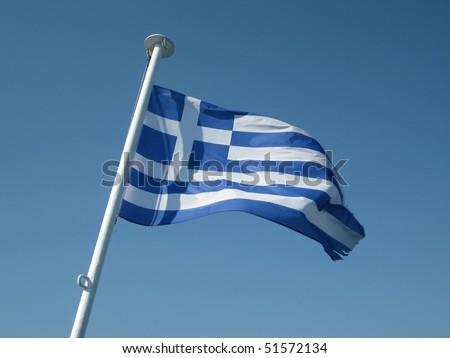 Greek flag on a blue skye - stock photo
