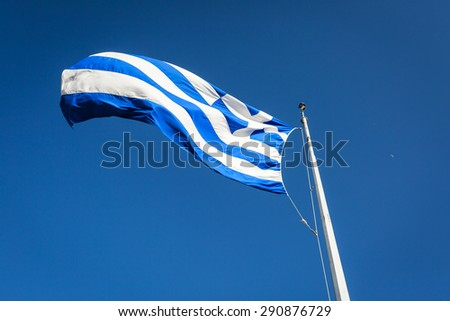 Greek flag on top of the acropolis in Athens - stock photo