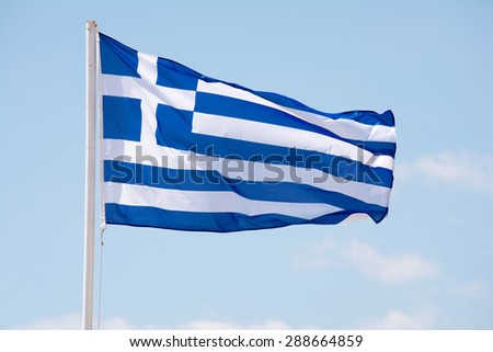 Greek flag waving on the wind - stock photo