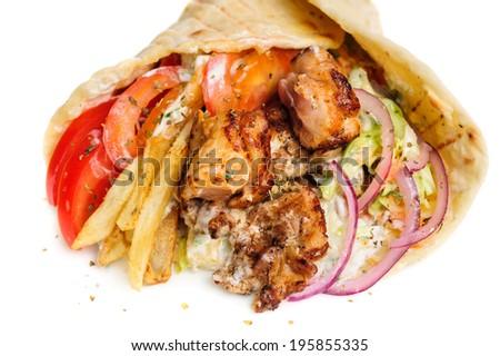 greek gyros stuffed with meat, salad, onion, tomato and potato - stock photo