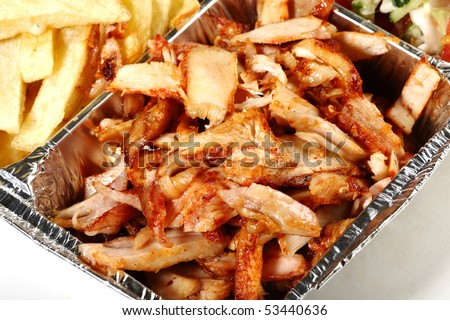 greek gyros with hummus french-fries and salad - stock photo