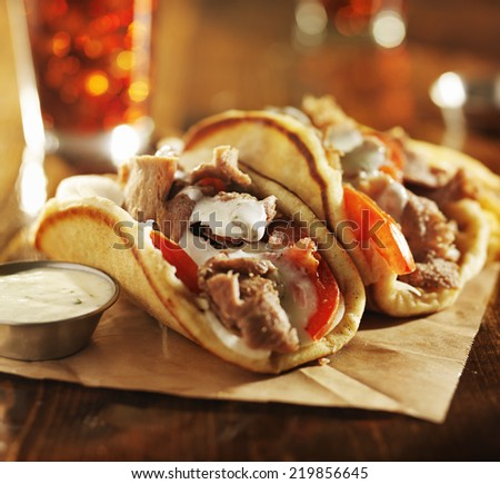 greek gyros with tzatziki sauce and fries - stock photo
