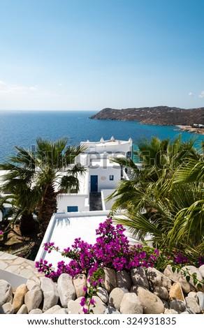 greek houses overlooking elia beach on mykonos - stock photo