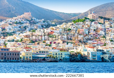 Greek island with colorful houses and yachts. - stock photo