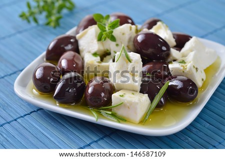 Greek Kalamata olives and feta cheese with olive oil, a mediterranean snack - stock photo