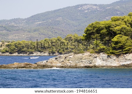 Greek landscape with water, trees and mountains