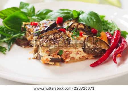Greek moussaka dish with eggplant or aubergine and minced meat - stock photo