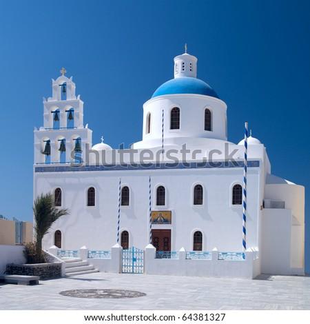 Greek orthodox church in Oia village on Santorini - stock photo