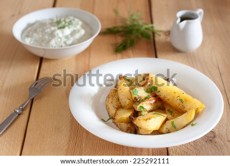 greek potatotes, tzatziki and lemon vinaigrette - stock photo