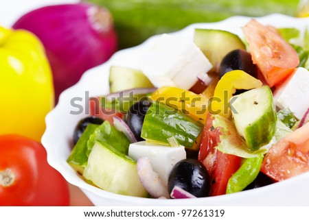 Greek salad and ingredients to it