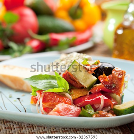Greek Salad (Feta Cheese,  Olive and Vegetables) with Toast - stock photo