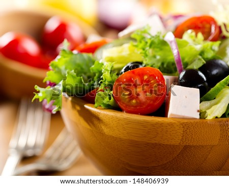 greek salad in a bowl - stock photo