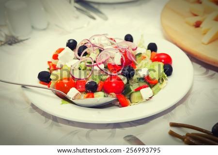 Greek salad in a restaurant - stock photo