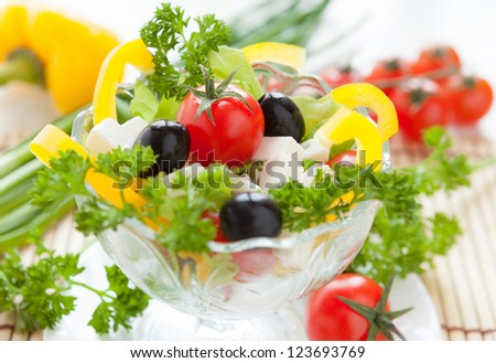 Greek salad in a transparent bowl, food close up