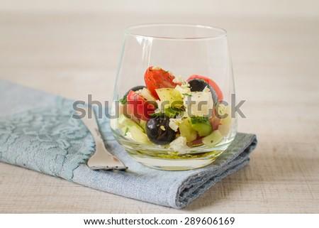 Greek salad in an elegant glass - stock photo